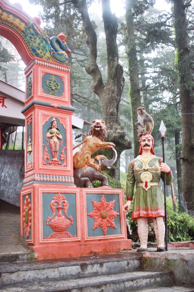 Entrance and monkey at Jakhu Temple in Shimla, India