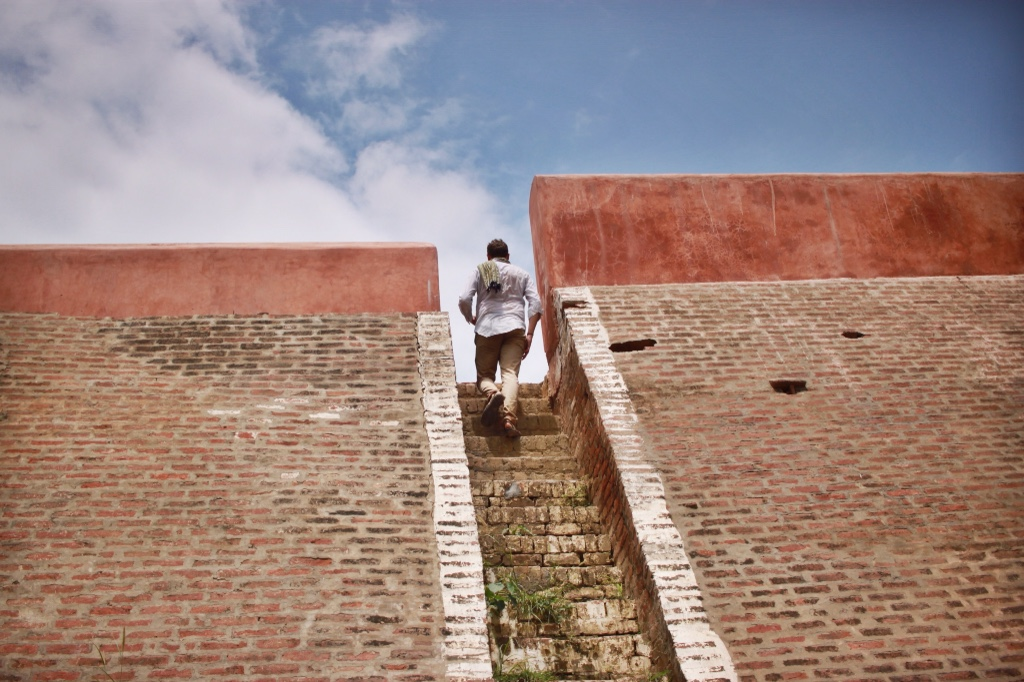 Alexander climbing stairs in Amritsar, India