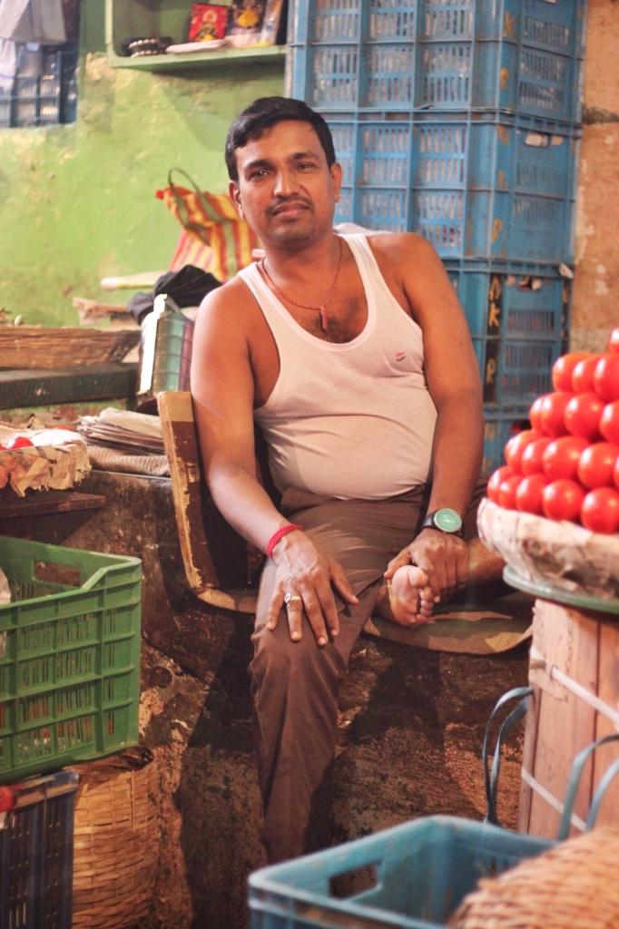 Mumbai market man with fruit stand