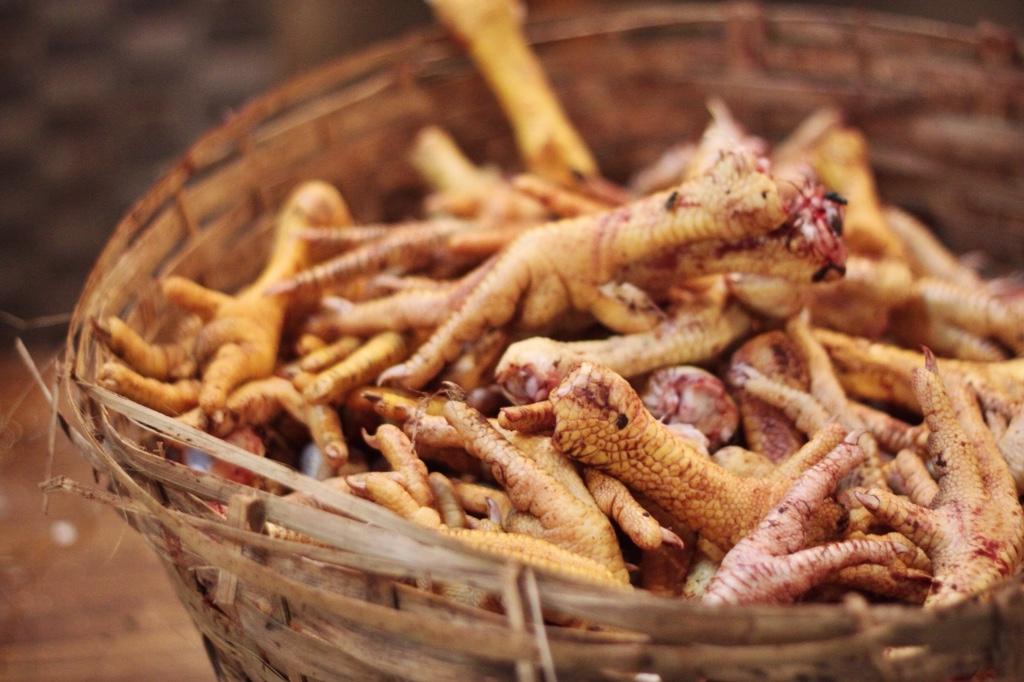 Mumbai market chicken feet in basket
