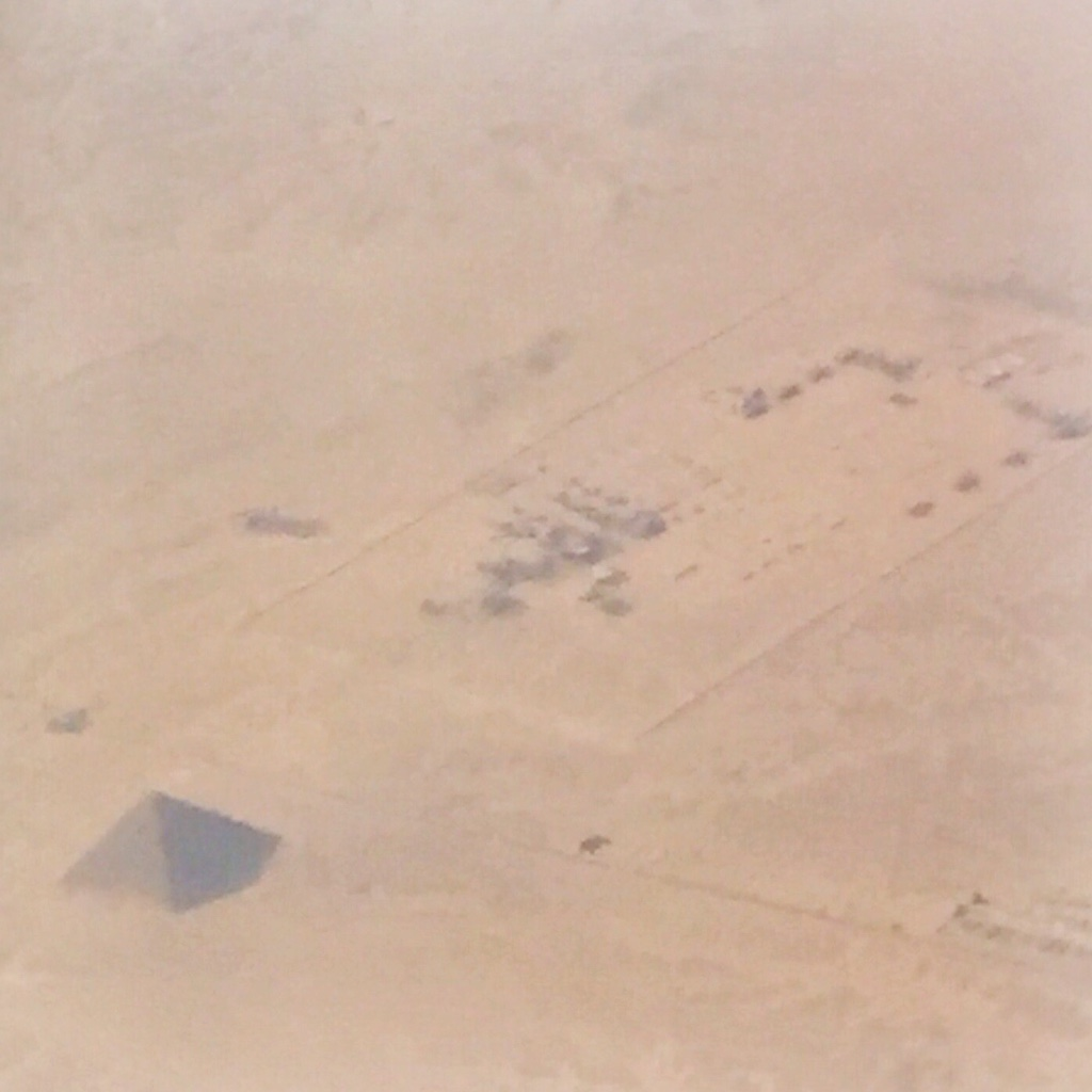 Pyramid and ruins as seen from airplane.